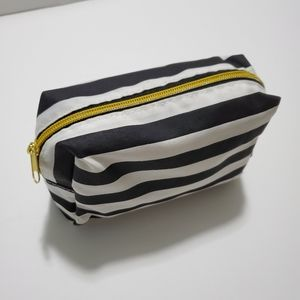 black and white striped Sephora cosmetic bag